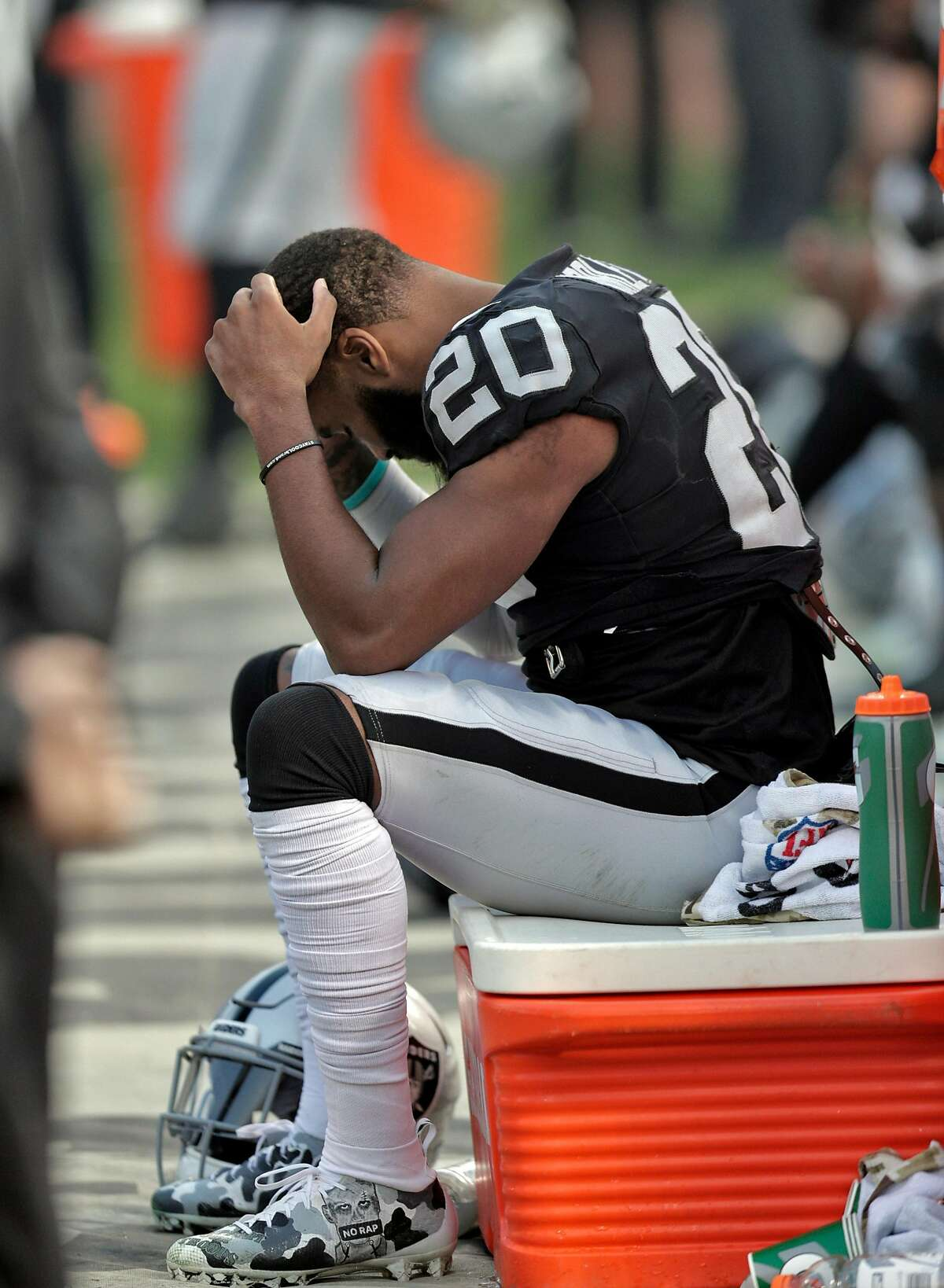 Cornerback Daryl Worley (20) on the bench in the final seconds of the game as the Oakland Raiders play the Los Angeles Chargers at the Coliseum in Oakland, Calif., on Sunday, November 11, 2018. The Chargers won 20-6.