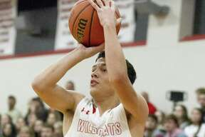 Splendora guard Adam Carter (22) shoots a three-pointer during the first quarter of a boys basketball game during the Splendora Invitational at Splendora High School, Friday, Dec. 1, 2017, in Splendora.