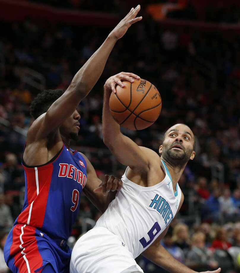 Charlotte's Tony Parker (9) makes a move on Detroit's Langston Galloway on Sunday. Photo: Carlos Osorio / Associated Press