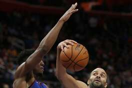 Charlotte Hornets guard Tony Parker (9) fakes a pass as Detroit Pistons guard Langston Galloway (9) defends during the first half of an NBA basketball game, Sunday, Nov. 11, 2018, in Detroit. (AP Photo/Carlos Osorio)