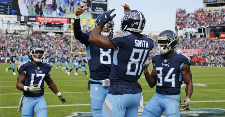 Tennessee Titans tight end Jonnu Smith (81) celebrates with quarterback Marcus Mariota (8) after Smith caught a touchdown pass against the New England Patriots in the first half of an NFL football game Sunday, Nov. 11, 2018, in Nashville, Tenn. (AP Photo/James Kenney)