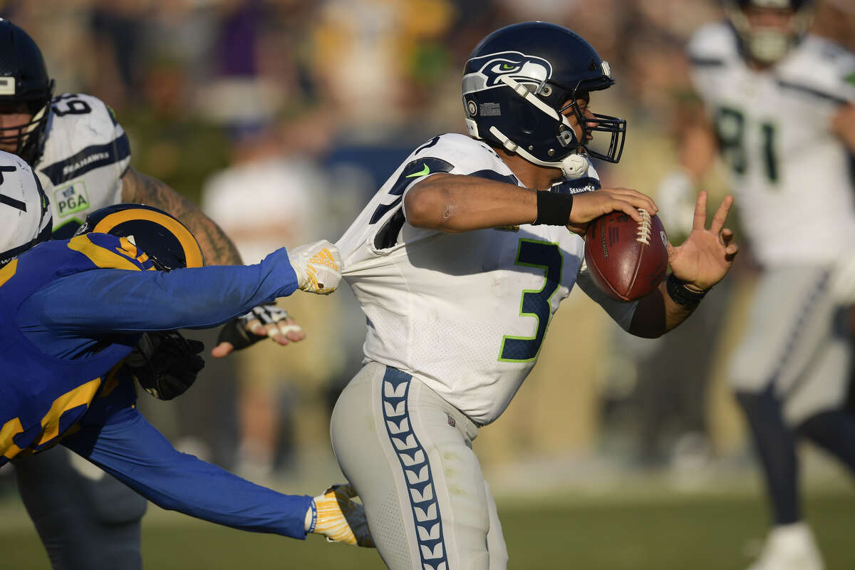 SEAHAWKS CAN'T GET IT DONE ON FINAL DRIVE -- AGAIN After a big, late-game defensive series by the Seahawks to get the ball with 1:35 left in the game -- and the chance to upset the Rams -- they couldn't convert. Russell Wilson opened the final drive with a 29-yard completion to Tyler Lockett and an 11-yard scramble, but miscued on three consecutive passes to essentially end the game with 26 seconds left.