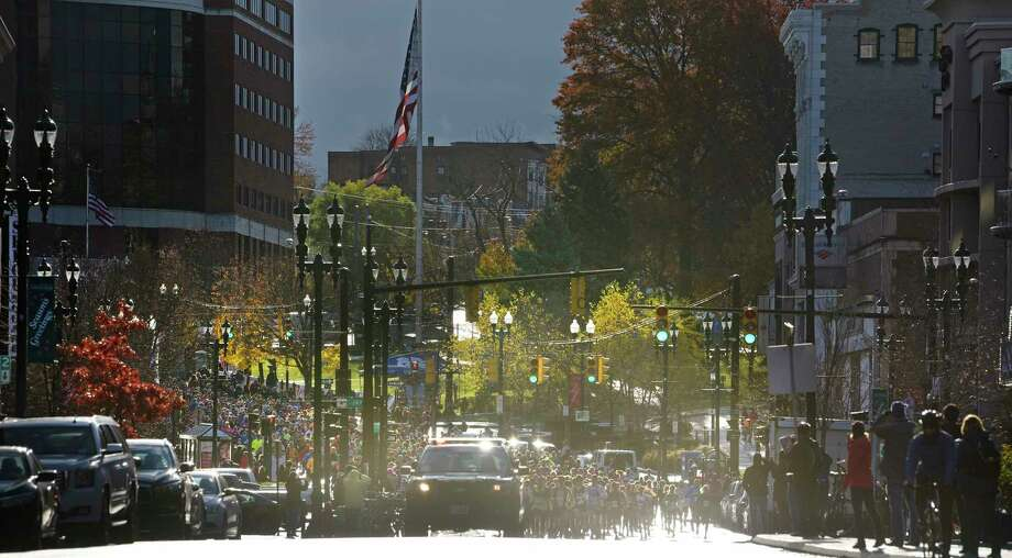 Runners make their way down State Street at the start of the Stockade-athon on Sunday, Nov. 11, 2018, in Schenectady, N.Y.  (Paul Buckowski/Times Union) Photo: Paul Buckowski / (Paul Buckowski/Times Union)