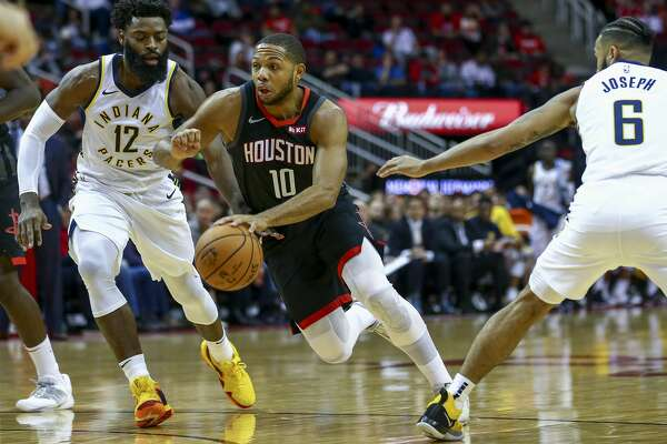 Houston Rockets guard Eric Gordon (10) dribbles past Indiana Pacers guard Tyreke Evans (12) and guard Cory Joseph (6) during the first quarter of the NBA game at Toyota Center Sunday, Nov. 11, 2018, in Houston.