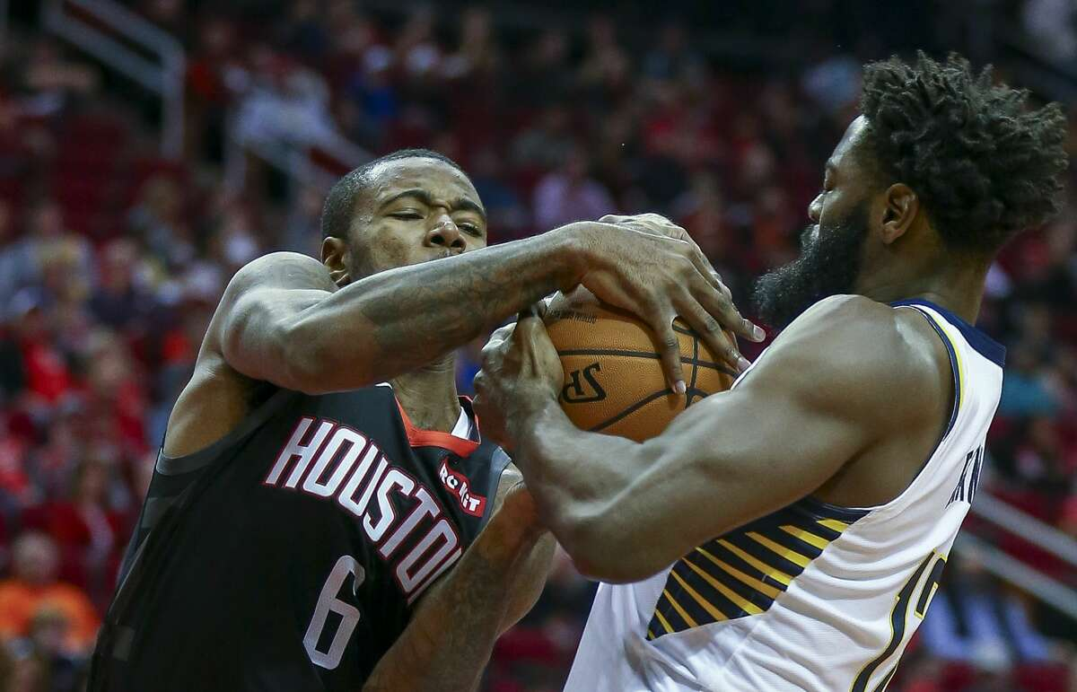 Houston Rockets forward Gary Clark (6) and Indiana Pacers guard Tyreke Evans (12) battle for control of the ball during the first quarter of the NBA game at Toyota Center Sunday, Nov. 11, 2018, in Houston.