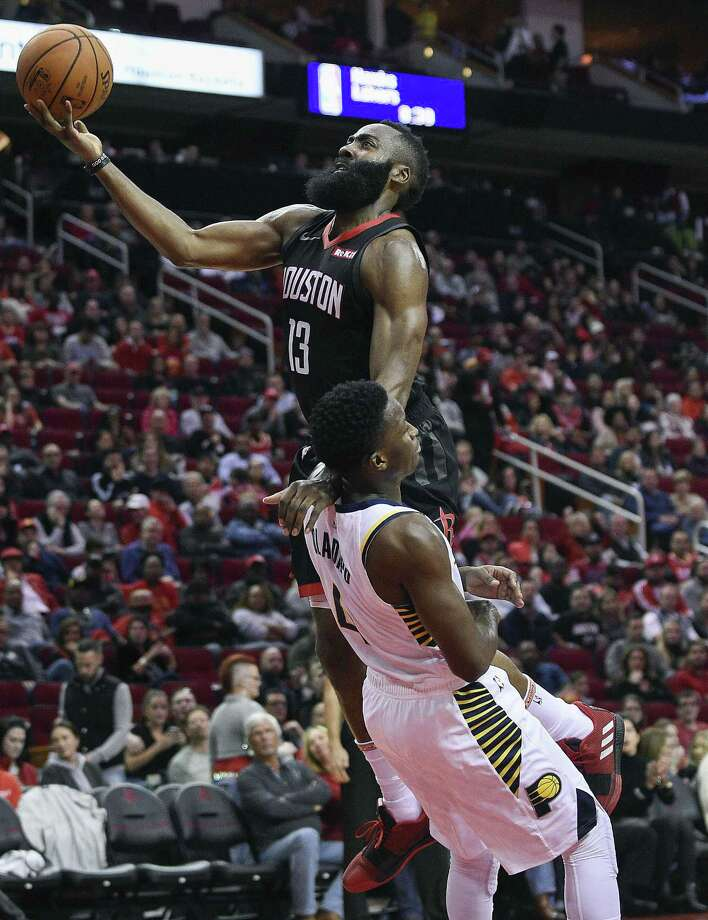 Houston Rockets guard James Harden, top, drives to the basket over Indiana Pacers guard Victor Oladipo during the second half of an NBA basketball game, Sunday, Nov. 11, 2018, in Houston. Photo: Eric Christian Smith, FRE / Associated Press / Copyright 2018 The Associated Press. All rights reserved.