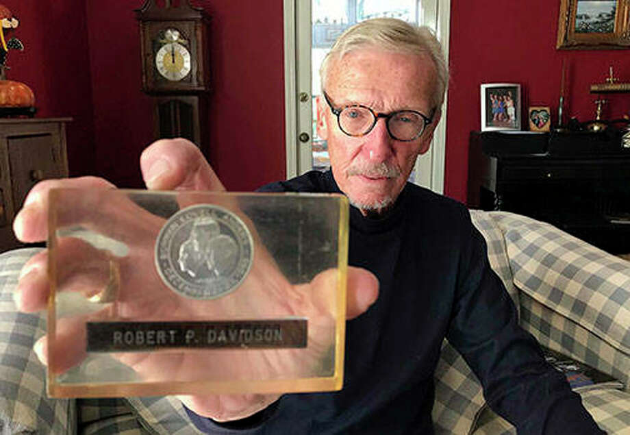 Bob Davidson holds a coin made with metal that went to moon. Davidson, a former NASA employee, got to pal around with Apollo 11 astronauts Neil Armstrong and Buzz Aldrin as he helped design the revolutionary spacesuits those men wore for the first steps on the moon on July 20, 1969. Photo: Burt Constable | Daily Herald (AP)