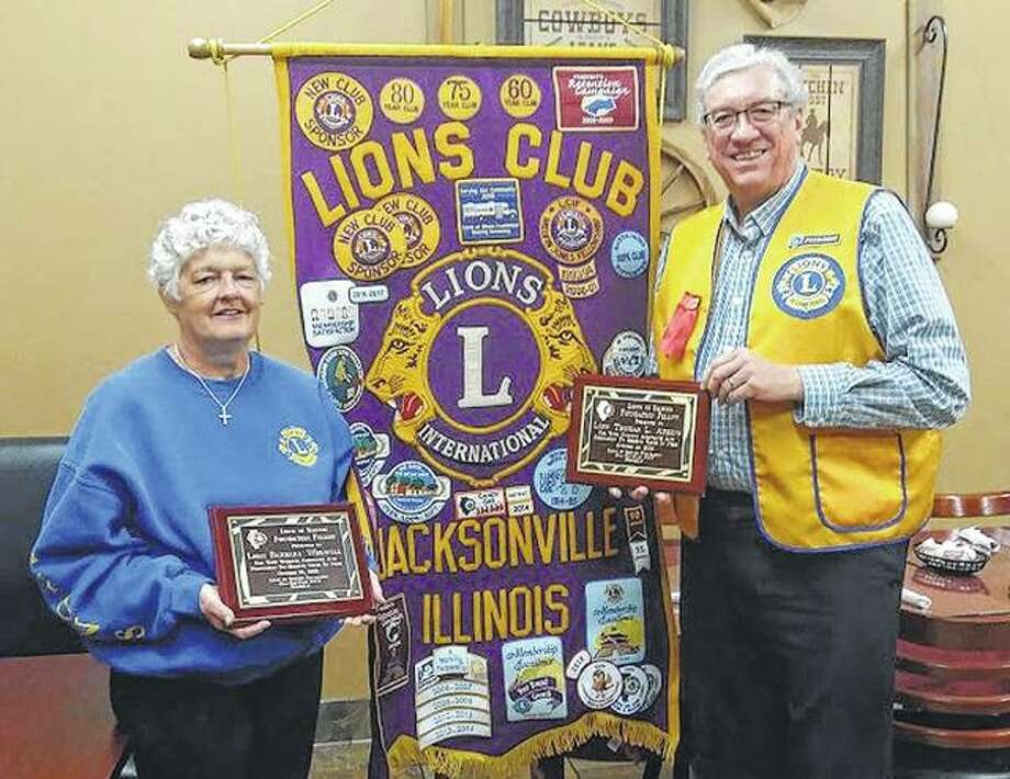 The Lions of Illinois Foundation recognized Barb Whewell and Tom Atkins on Oct. 17 as recipients of the foundation's Fellowship Award. The award is given for service as a legacy in the spirit of the Lions motto, 'We Serve'. The awards were presented by Dale Shafer, club treasurer. Whewell serves as the club secretary. Atkins is the club president. Photo: Photo Provided
