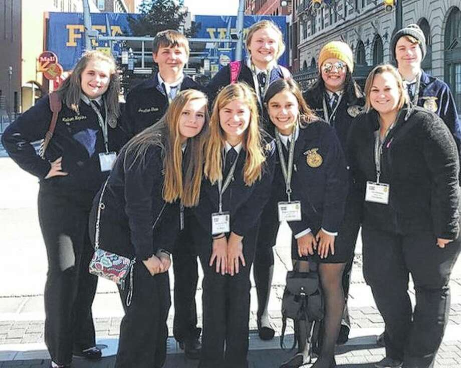 Several Bluffs FFA members traveled Oct. 23 to Indianapolis to take part in the 91st National FFA Convention and Expo. During the convention they took part in opening sessions, a hypnotist show and a career fair. They also enjoyed a Garth Brooks concert and visited the Indianapolis Children's Museum. Among those attending were Sydney Whicker (front row, from left), Alyssa Bartels, Kaydence Gregory and sponsor Liz Alloway; Madison Hopkins (back row, from left), Jonathan Shaw, Morgan Hoots, Ericka Huseman and Ethan Buhlig. Photo: Photo Provided