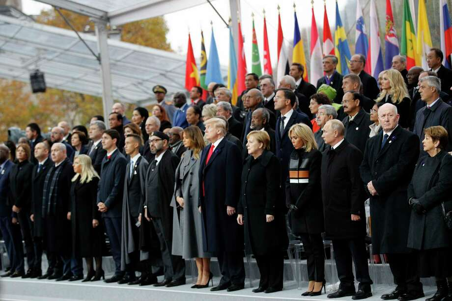 Heads of states and world leaders attend ceremonies at the Arc de Triomphe Sunday, Nov. 11, 2018 in Paris. Over 60 heads of state and government were taking part in a solemn ceremony at the Tomb of the Unknown Soldier, the mute and powerful symbol of sacrifice to the millions who died from 1914-18. (AP Photo/Francois Mori, Pool) Photo: Francois Mori / Copyright 2018 The Associated Press. All rights reserved.