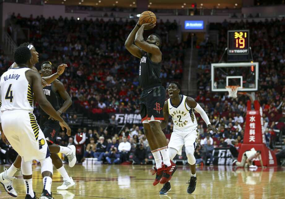 Houston Rockets guard James Harden (13) shoots a three-pointer against the Indiana Pacers during the first quarter of the NBA game at Toyota Center Sunday, Nov. 11, 2018, in Houston. The Rockets won 115-103. Photo: Godofredo A. Vasquez/Staff Photographer