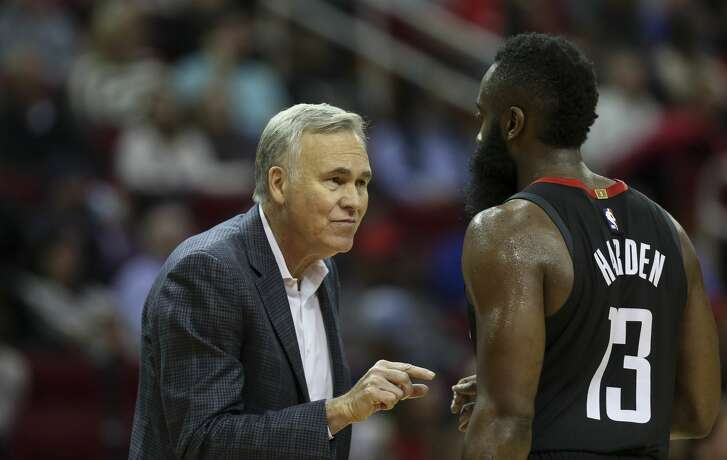 Houston Rockets manager Mike D'Antoni talks with guard James Harden (13) during a timeout in the second quarter of the NBA game against the Indiana Pacers at Toyota Center Sunday, Nov. 11, 2018, in Houston.