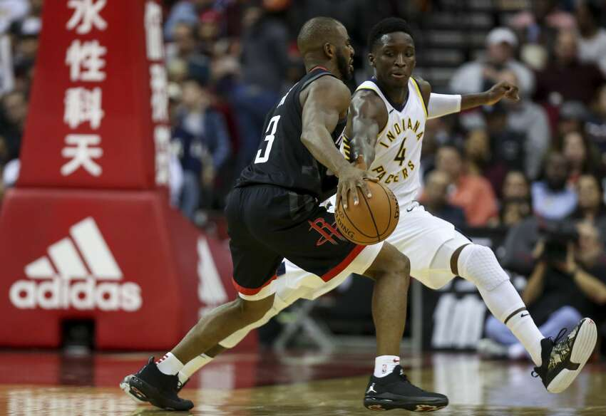 Indiana Pacers guard Victor Oladipo (4) tries to poke the ball away from Houston Rockets guard Chris Paul (3) during the third quarter of the NBA game at Toyota Center Sunday, Nov. 11, 2018, in Houston.