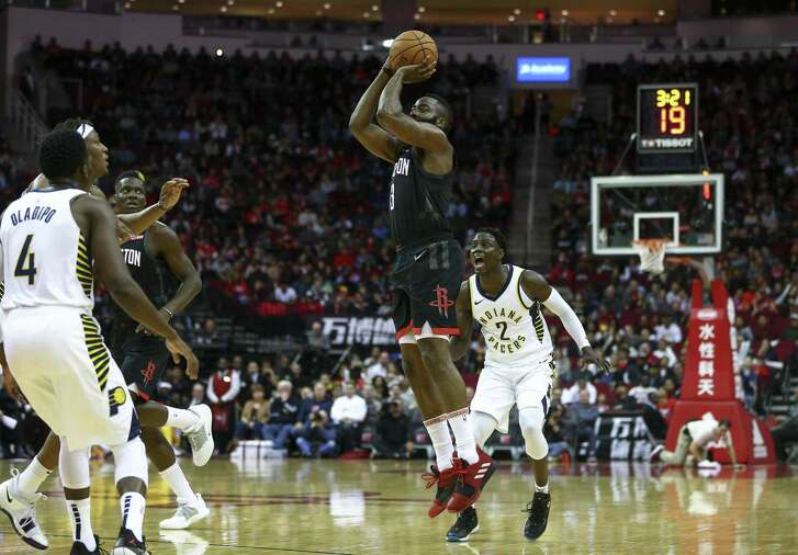 Houston Rockets guard James Harden (13) shoots a three-pointer against the Indiana Pacers during the first quarter of the NBA game at Toyota Center Sunday, Nov. 11, 2018, in Houston. The Rockets won 115-103.