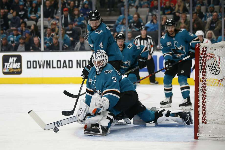 Sharks goaltender Martin Jones stops a first-period shot against the Flames at SAP Center. Jones finished with 29 saves as San Jose stopped a two-game slide. Photo: Josie Lepe / Associated Press