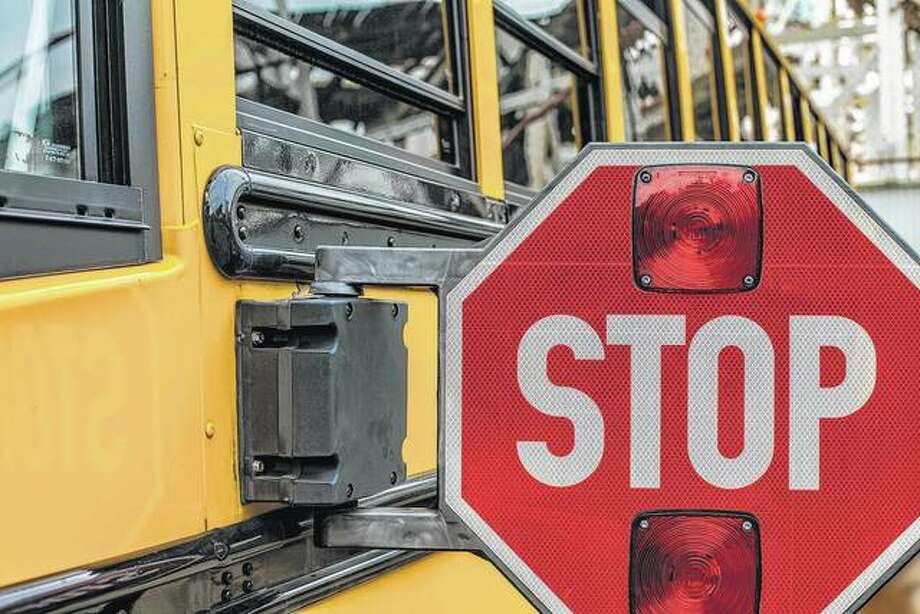 A school bus extends its stop-arm to warn motorists of the need to stop while children board and unboard. Photo: Getty Images