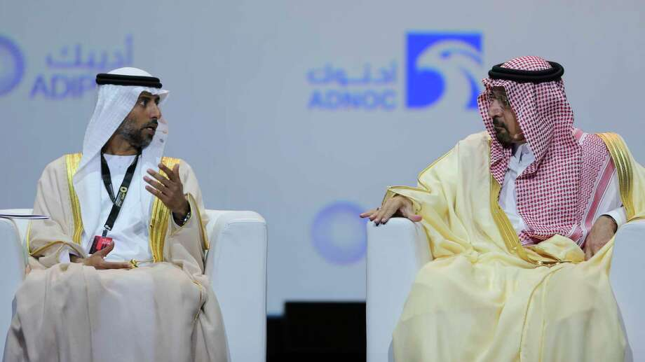 UAE Energy Minister Suhail al-Mazrouei, left, talks to Khalid Al-Falih, Saudi Energy and Oil Minister, in the opening ceremony of the Abu Dhabi International Exhibition & Conference, ADIPEC, in Abu Dhabi, United Arab Emirates, Monday, Nov. 12, 2018. OPEC and allied oil-producing countries likely need to cut crude supplies to rebalance the market after proposed U.S. sanctions on Iran failed to cut Tehran's output, top Saudi and Emirati energy officials said Monday.  NEXT: See which countries are part of OPEC. Photo: Kamran Jebreili, AP / Copyright 2018 The Associated Press. All rights reserved.