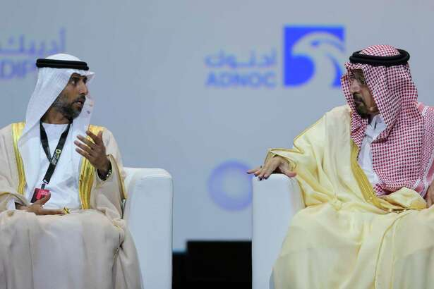 UAE Energy Minister Suhail al-Mazrouei, left, talks to Khalid Al-Falih, Saudi Energy and Oil Minister, in the opening ceremony of the Abu Dhabi International Exhibition & Conference, ADIPEC, in Abu Dhabi, United Arab Emirates, Monday, Nov. 12, 2018. OPEC and allied oil-producing countries likely need to cut crude supplies to rebalance the market after proposed U.S. sanctions on Iran failed to cut Tehran's ouput, top Saudi and Emirati energy officials said Monday.