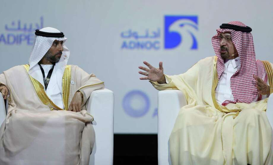 UAE Energy Minister Suhail al-Mazrouei, left, listens to Khalid Al-Falih, Saudi Energy and Oil Minister, in the opening ceremony of the Abu Dhabi International Exhibition & Conference, ADIPEC, in Abu Dhabi, United Arab Emirates, Monday, Nov.12, 2018.  CONTINUE to see the countries in OPEC. Photo: Kamran Jebreili, AP / Copyright 2018 The Associated Press. All rights reserved.