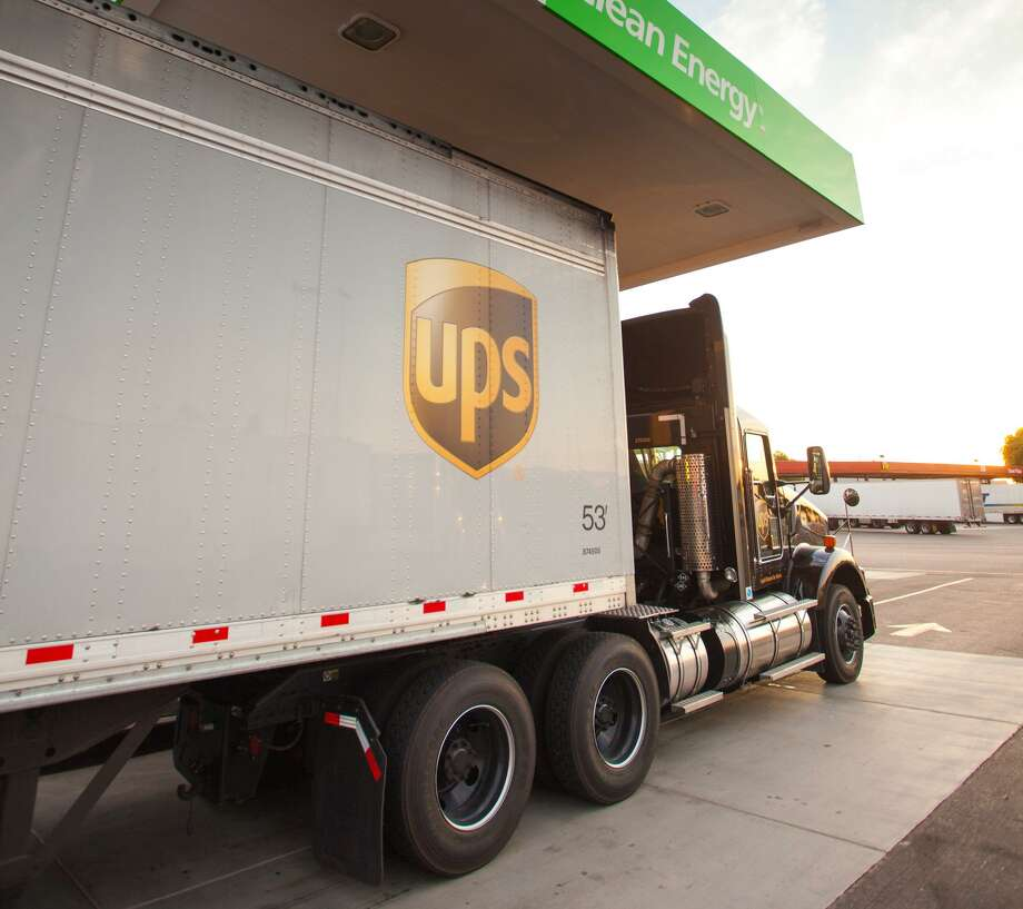 A UPS truck fills up at a Clean Energy Fuels liquefied natural gas fueling station in Phoenix in October 2013. (Scott Sporleder) Photo: Clean Energy Fuels