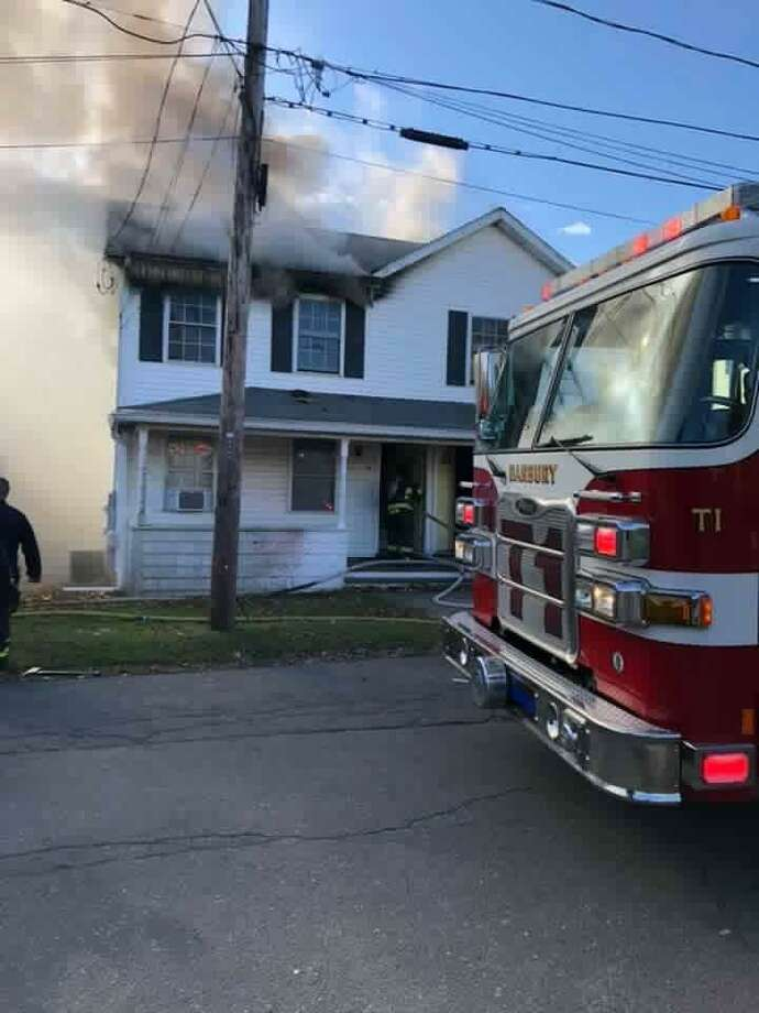 Firefighters battled flames at a Danbury home on Sunday afternoon. Photo: / Contributed Photo /Danbury Fire Department Facebook