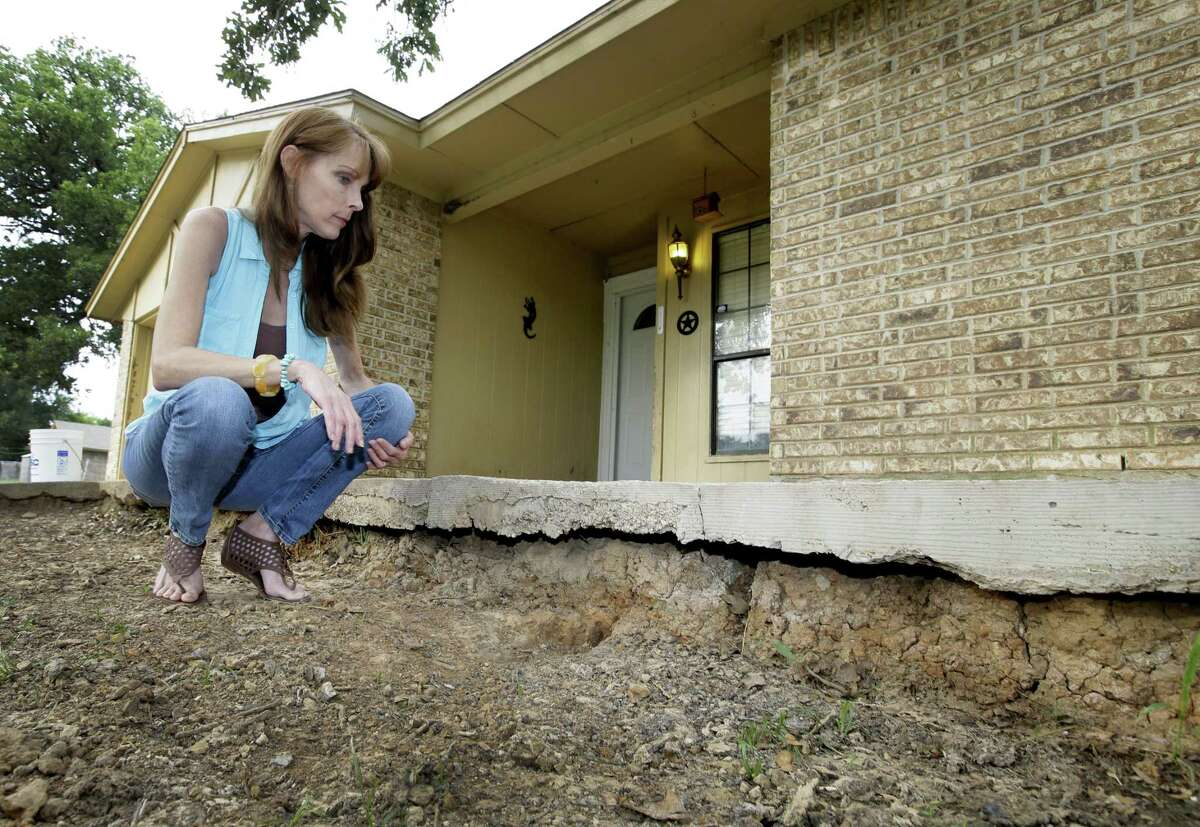 In 2014, Barbara Brown of Reno shows earthquake damage to her foundation that she says was caused by oil- and gas-related water disposal. She has since moved because of quakes.