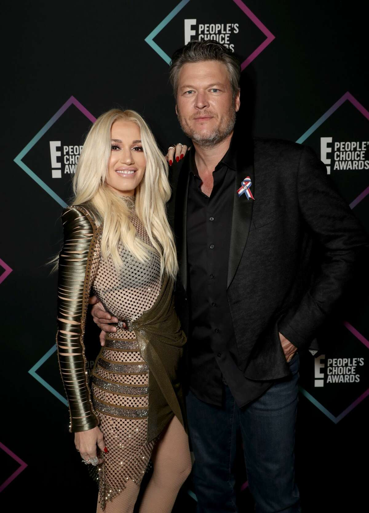 SANTA MONICA, CA - NOVEMBER 11: 2018 E! PEOPLE'S CHOICE AWARDS -- Pictured: (l-r) Gwen Stefani and Blake Shelton backstage during the 2018 E! People's Choice Awards held at the Barker Hangar on November 11, 2018 -- NUP_185073 -- (Photo by Todd Williamson/E! Entertainment/NBCU Photo Bank via Getty Images)