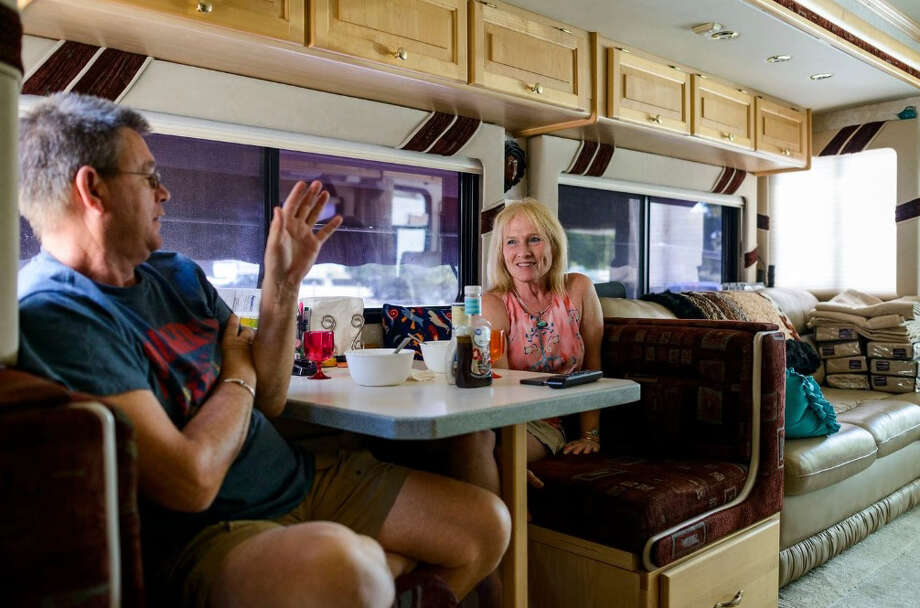 Chip Litchfield and his partner, Penni Brink, enjoy lunch in their RV at the Interstate 24 Campground in Smyrna, Tenn. Photo: Photo For The Washington Post By William DeShazer / The Washington Post