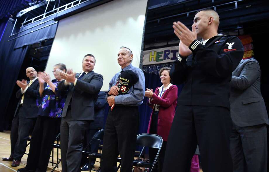 Korean War veteran Charles Salerno, second from right, one of six New Haven brothers who served during wartime, is honored during a Veterans Day program at Fair Haven School in New Haven on Friday. Photo: Arnold Gold / Hearst Connecticut Media / New Haven Register