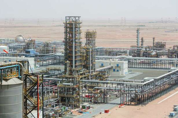 Cracking towers stand at the Ruwais refinery and petrochemical complex, operated by Abu Dhabi National Oil Co. in Al Ruwais, United Arab Emirates, on May 14, 2018.