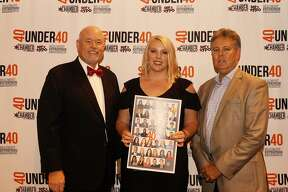 Publisher of the Beaumont Enterprise Mark Adkins, 40 Under 40 Honoree Laura Winegeart and Executive Director of the Greater Beaumont Chamber of Commerce Bill Allen.