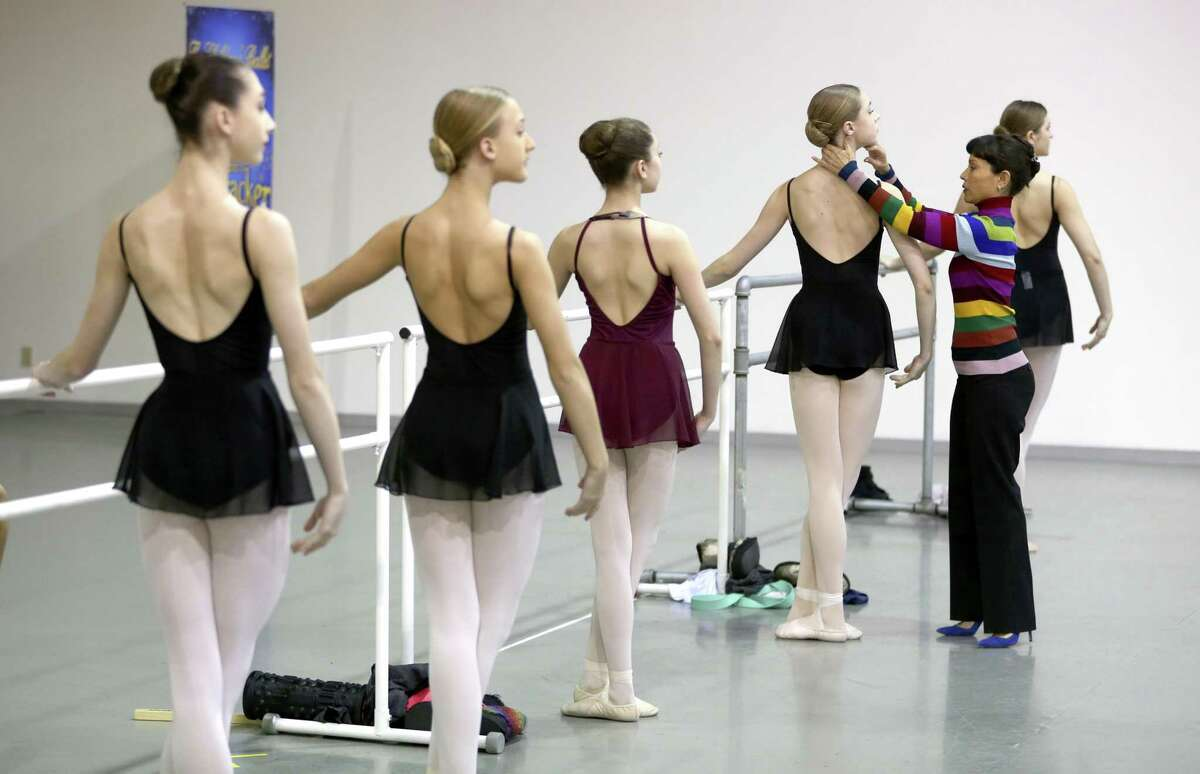 Children's Ballet of San Antonio founder Vanessa Bessler, right, gives position directions to dancer Lucy Hassmann during a rehearsal at Bessler's studio.
