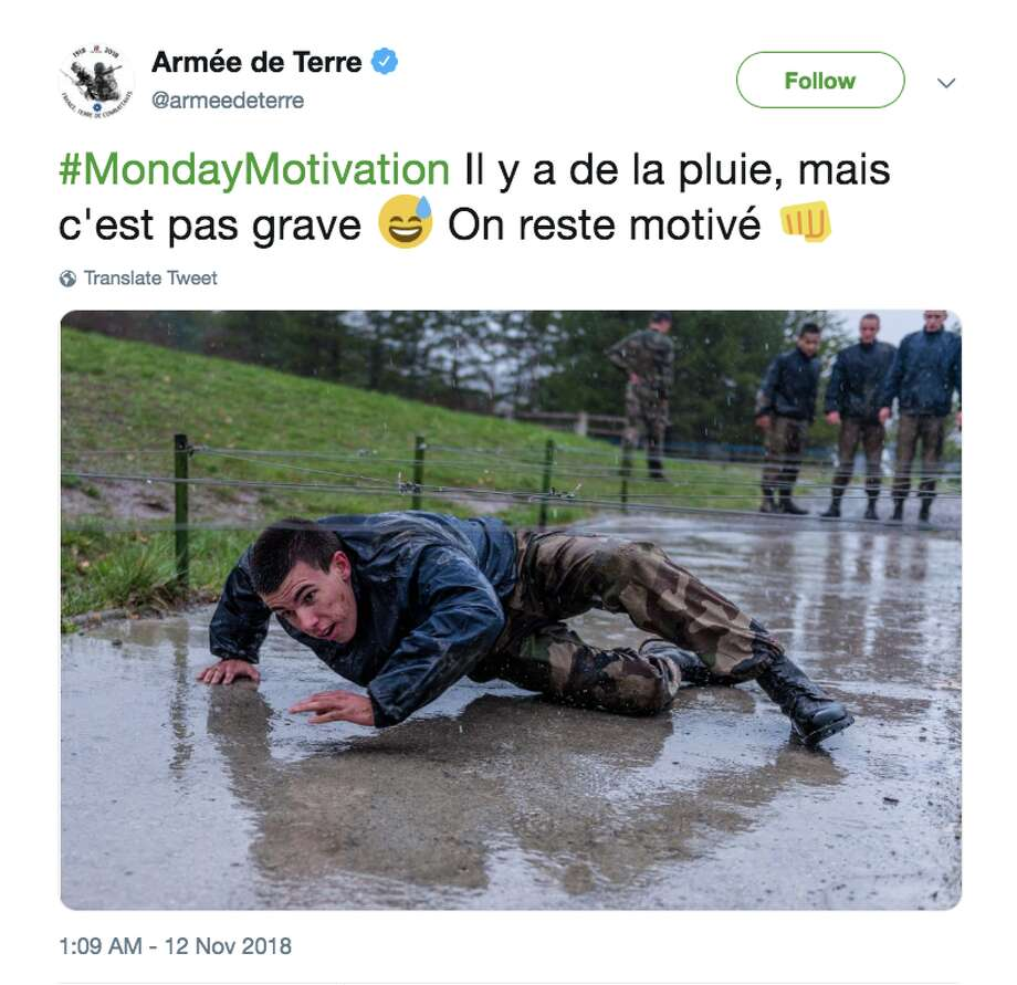 """There is rain, but it does not matter,"" the French army said Monday on Twitter, alongside a photo of a rain-soaked recruit crawling through an obstacle. ""We remain motivated."" Photo: Armée De Terre Via Twitter"