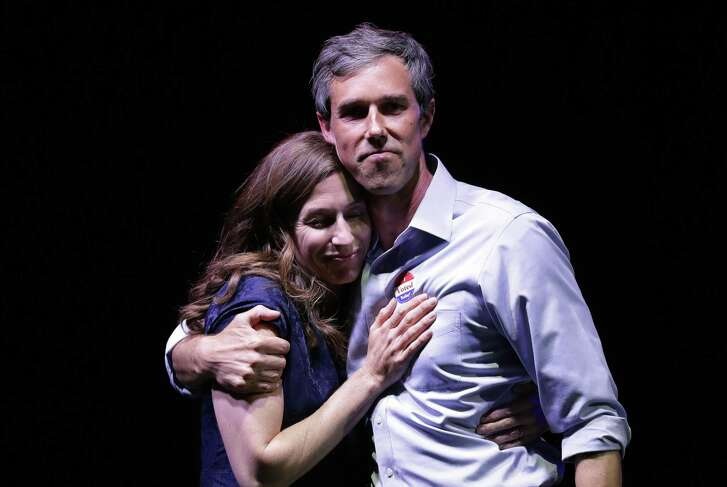 U.S. Rep. Beto O'Rourke, the 2018 Democratic Candidate for U.S. Senate in Texas, right, and his wife, Amy Sanders, stand together during his election night party, Tuesday, Nov. 6, 2018, in El Paso, Texas., after he was defeated by Sen. Ted Cruz, R-Texas. (AP Photo/Eric Gay)
