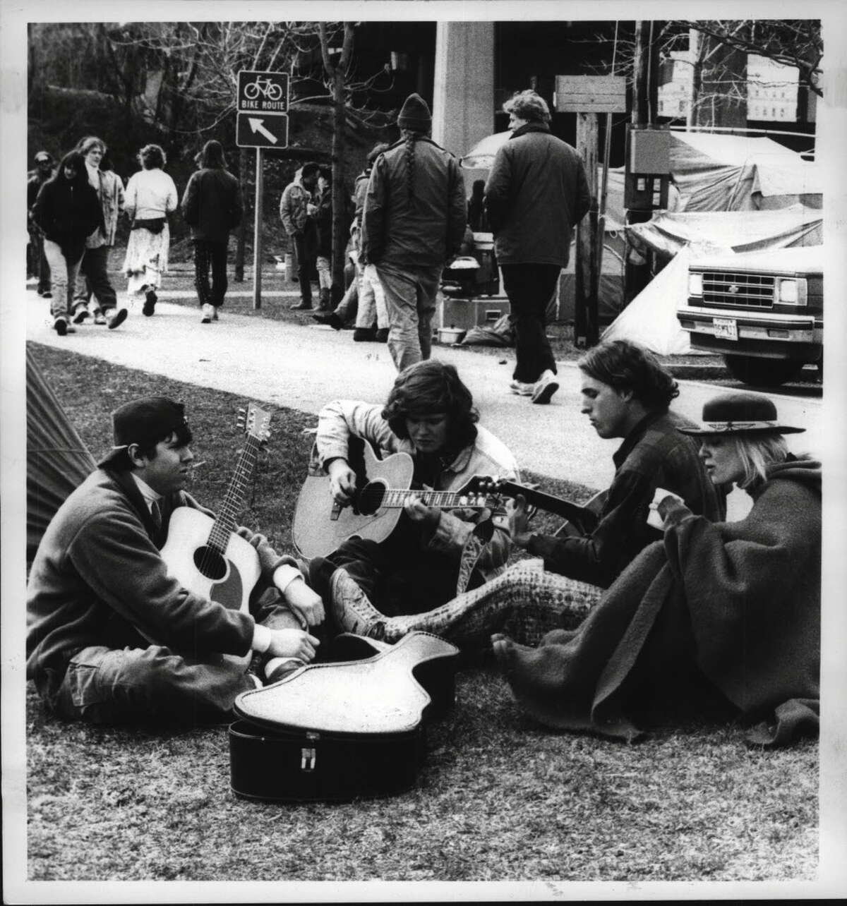 March 24, 1990: Deadheads from around the country gather for an impromptu jam session at the Corning Preserve while waiting for that night's Grateful Dead concert. Left to right: Rob Striker, Westchester, New York; Brendan Walsch, Montreal; Scott Mysers, Orlando, Florida; Dana Peterson, Dallas, Texas.