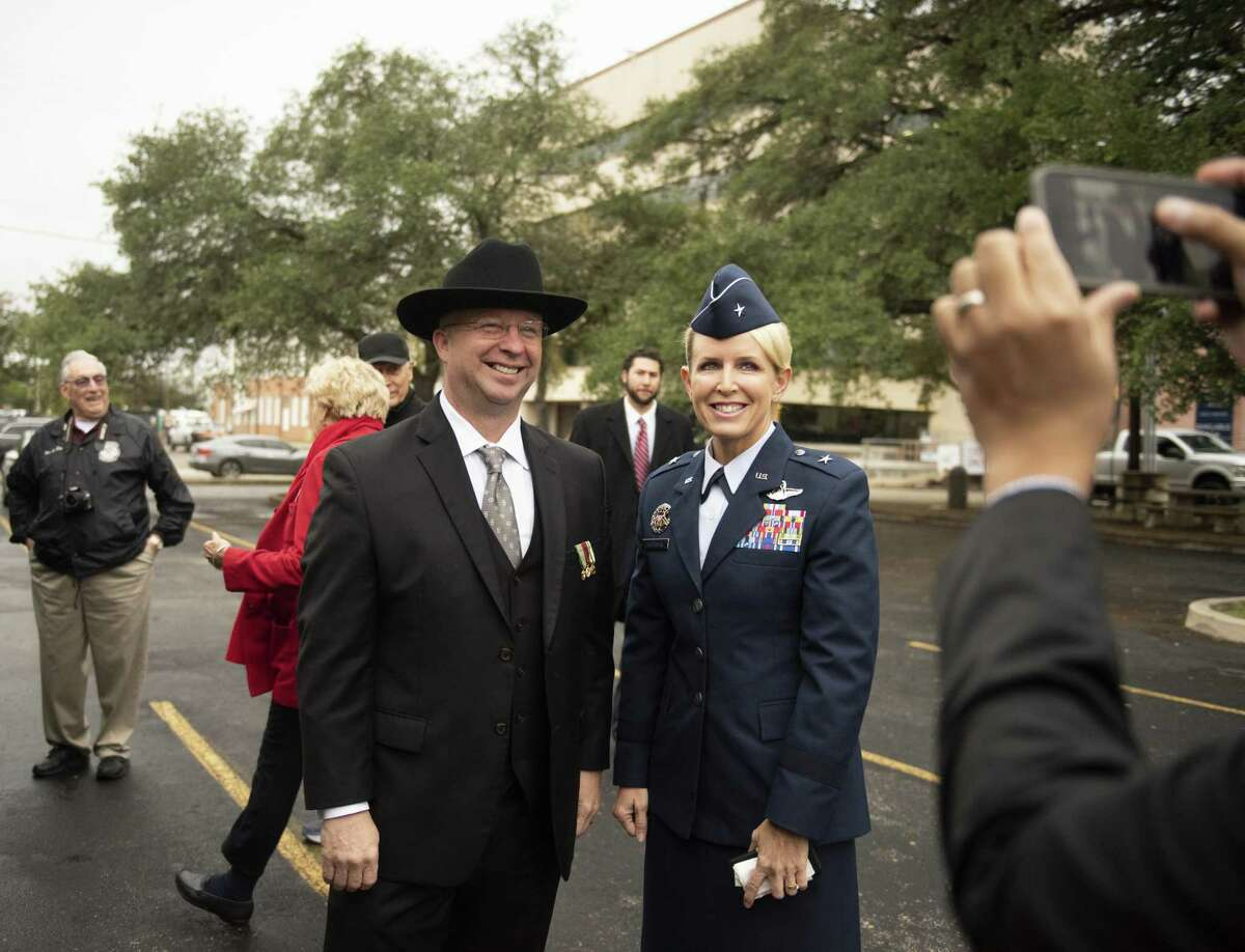 """Bexar County Precinct 3 Commissioner Kevin Wolff joins Brig. Gen. Laura Lenderman as Bexar County officials gather near Fort Sam Houston on Monday for the opening of the county's new Military and Veterans Services Center. Commissioner Kevin Wolff, the county's veterans liaison who has been working on to launch the expanded office, said Bexar is doubling its investment in veterans services, hoping to reach further """"inside the gate"""" to attract and help soon-to-be veterans transition to civilian life here."""