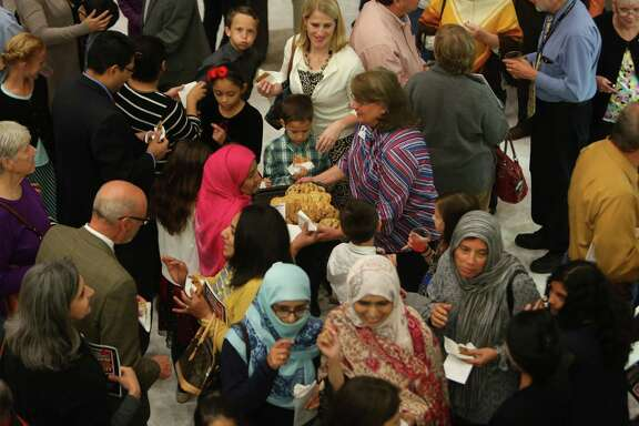 People mingle during a reception following an interfaith Thanksgiving worship service hosted at Christ Church Sugar Land United Methodist Church, Monday, Nov. 21, 2016, in Sugar Land.