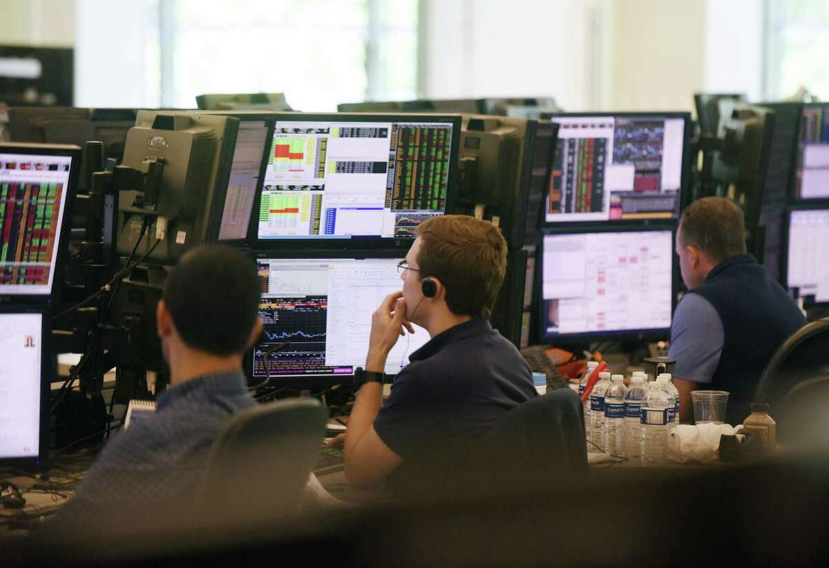 Investment professionals work on the trading floor at Point72 Asset Management's global headquarters at 72 Cummings Point Road in Stamford, Conn., on July 18, 2016.