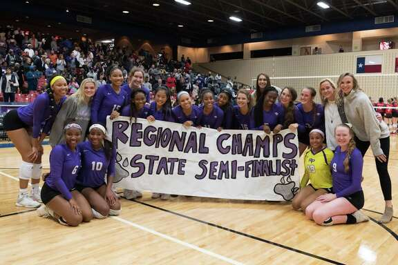 The Ridge Point Panthers pose for a photo after defeating the Dawson Eagles in the Region III 6A Championship volleyball game on Saturday, Nov. 10, at Wheeler Field House in Sugar Land.