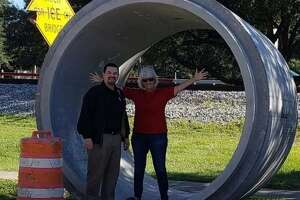 Katy City Councilman Chris Harris and City Councilwoman Janet Corte check out the 8-foot diameter storm sewer pipes that will be used in the First Street project that includes flood mitigation and a road upgrade.