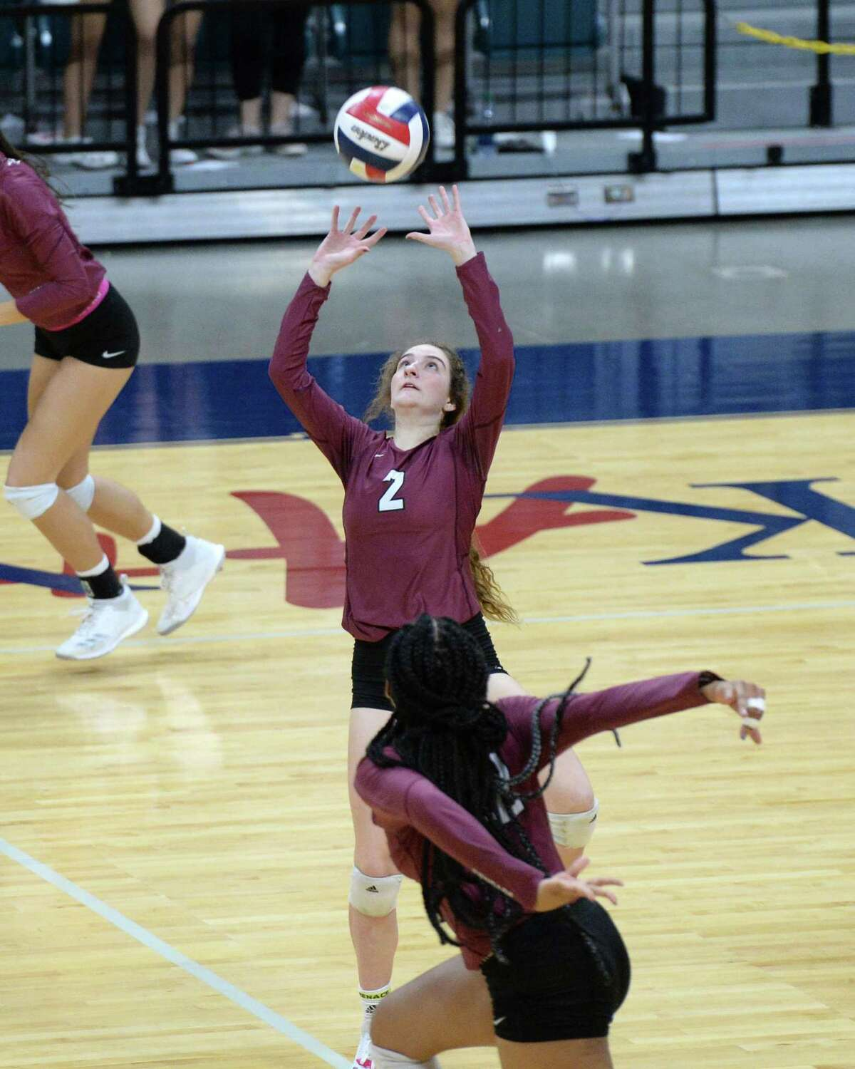 Eva Fitzgerald (2) of Cinco Ranch sets a ball in the third set of a Class 6A - III Regional Quarterfinal playoff volleyball match between the Cinco Ranch Cougars and the Katy Tigers on Monday, November 5, 2018 at the Leonard Merrell Center, Katy, TX.