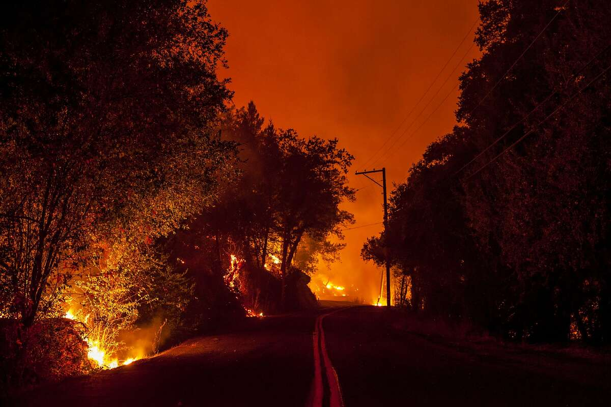 Slow burning fire burned on both sides of Mt Veeder road as flames from the Nuns Fire continues to burn west of downtown Napa, California, USA 10 Oct 2017.
