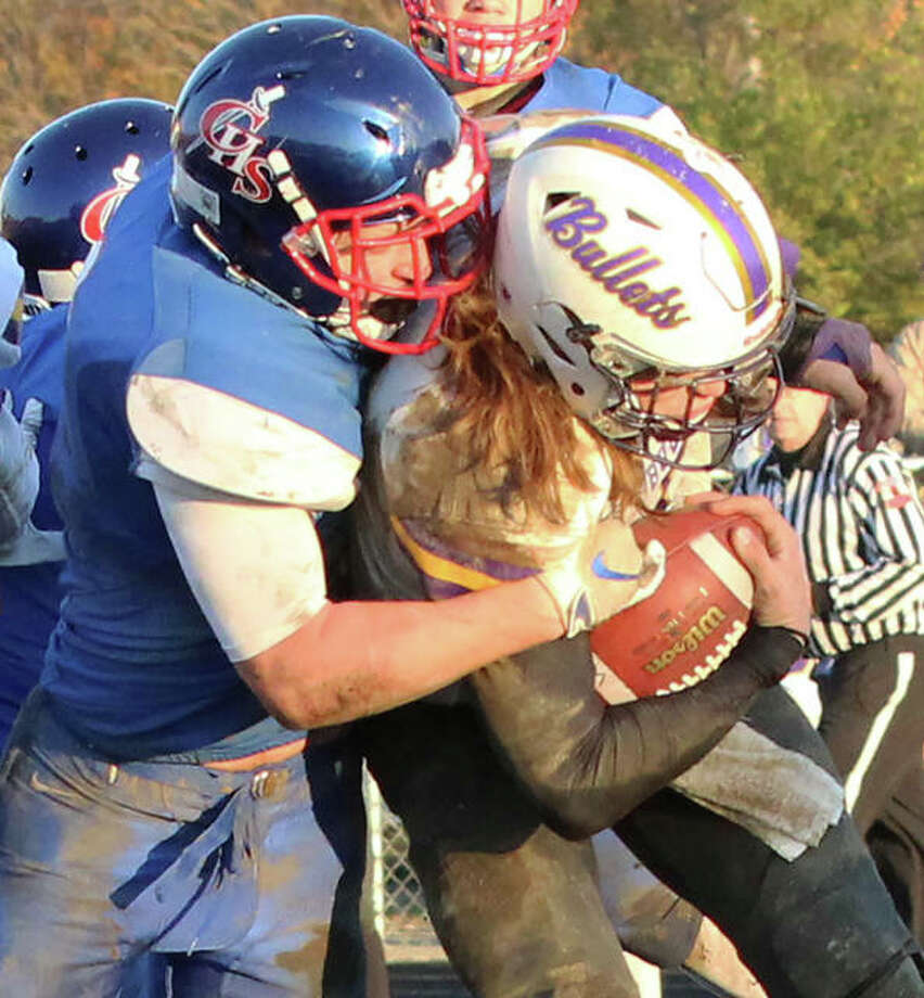 Carlinville's Colton DeLong (left) takes down Williamsville QB Damon Coady during a Class 3A prep football quarterfinal game at Carlinville. The Cavaliers defeated the Bullets 35-21 to improve to 12-0 and advance to next's Saturday's semifinals against the 12-0 Monticello Sages in Monticello. Photo: Greg Shashack / The Telegraph