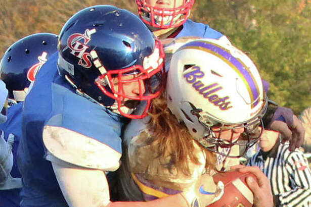 Carlinville's Colton DeLong (left) takes down Williamsville QB Damon Coady during a Class 3A prep football quarterfinal game at Carlinville. The Cavaliers defeated the Bullets 35-21 to improve to 12-0 and advance to next's Saturday's semifinals against the 12-0 Monticello Sages in Monticello.