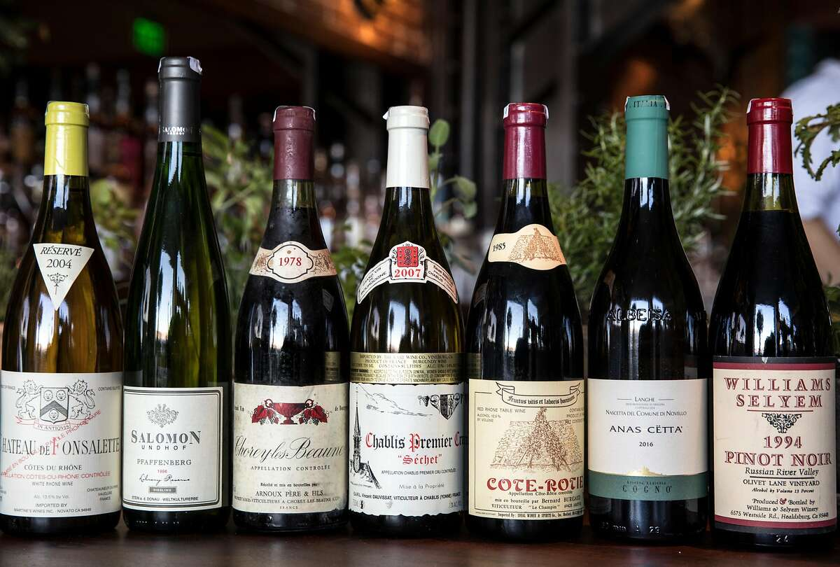 Vintage bottles of wine are lined up on the bar by head sommelier Morgan Harris at Angler along the Embarcadero in San Francisco, Calif. Wednesday, Nov. 7, 2018.
