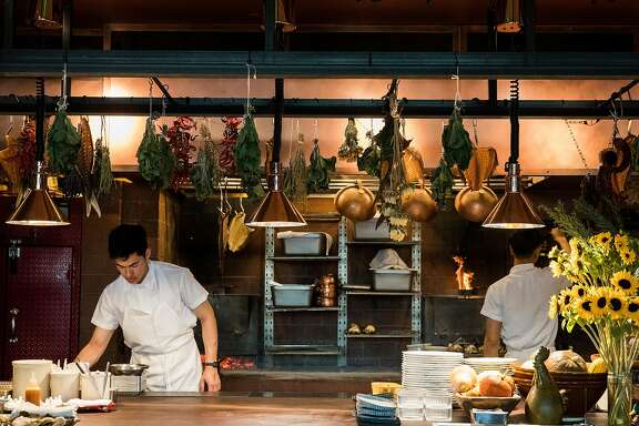 Line cooks work to prepare dinner for guests inside the kitchen of Angler along the Embarcadero in San Francisco, Calif. Wednesday, Nov. 7, 2018.