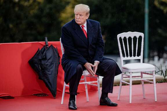 U.S. President Donald Trump looks on while seated during the American Commemoration Ceremony at the Suresnes American Cemetery in Paris, France, on Sunday, Nov. 11, 2018. Trump spoke at a military cemetery near Paris, a day after drawing sharp criticism for canceling a trip to a separate cemetery during centenary commemorations of the end of World War I. Photographer: Marlene Awaad/Bloomberg