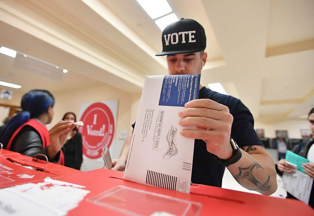 FILE - A man casts his ballot at City Hall in San Francisco, California on November 6, 2018. Proposition 24 passed at this year's general election with a 56.2% majority vote.