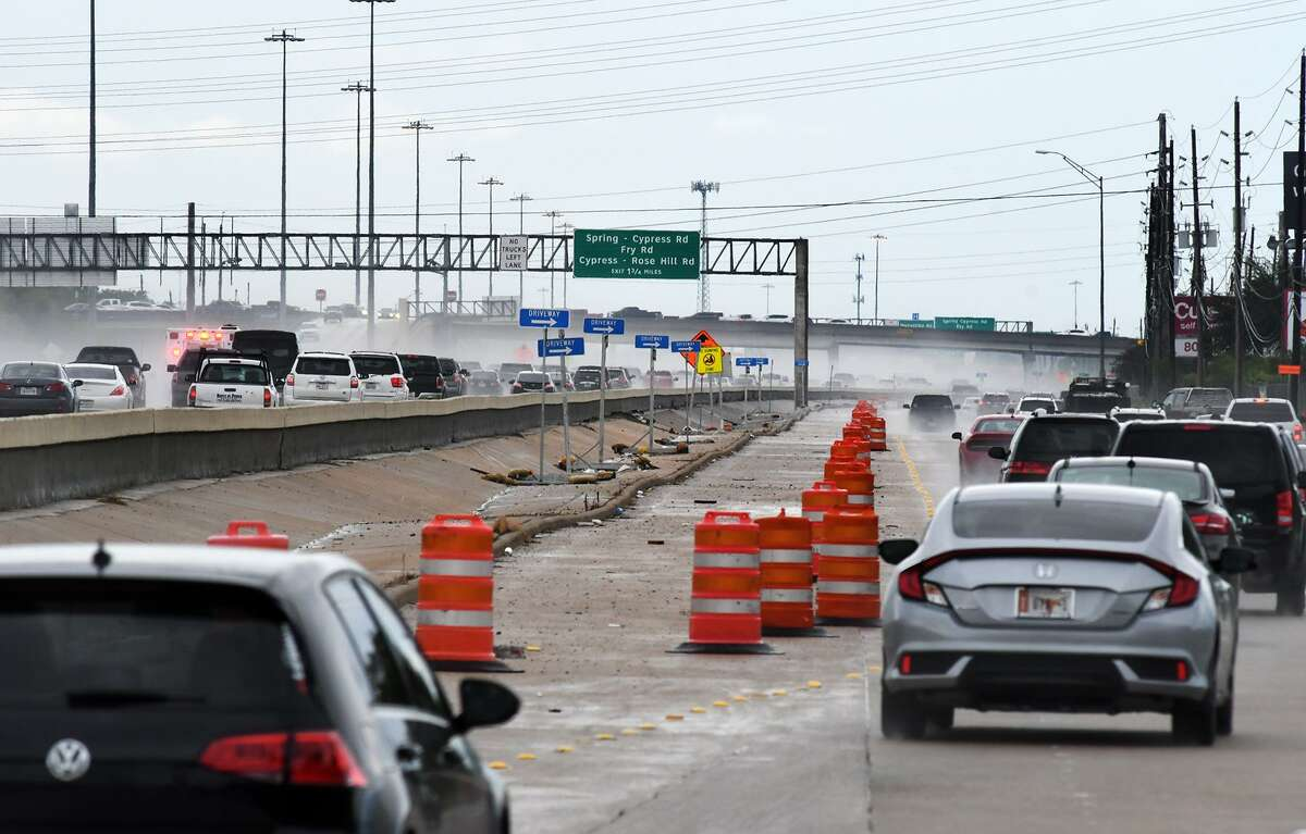 Traffic splits from the main lanes of Highway 290 to the service road exit for Barker Cypress on Sept. 13, 2018.