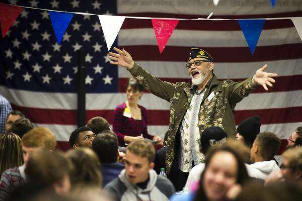 Rocky Maldonado speaks to a group of Midland High students during a Veterans Day event on Monday, Nov. 12, 2018 at the school. Maldonado was one of about 75 veterans who told stories of their time in the armed forces. For more photos from the event, go to www.ourmidland.com. (Katy Kildee/kkildee@mdn.net)